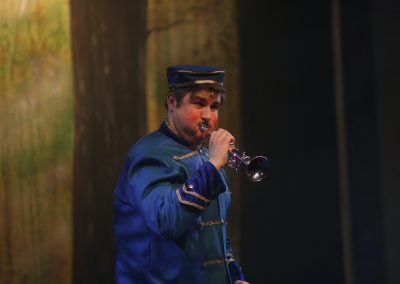 Buttons Playing the Trumpet